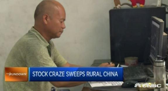 Ein Bauer wählt Aktien für die Geldanlage aus. Screenshot von CNBC